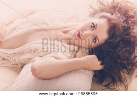 Portrait Of Sexy Girl Lying On Pillows.