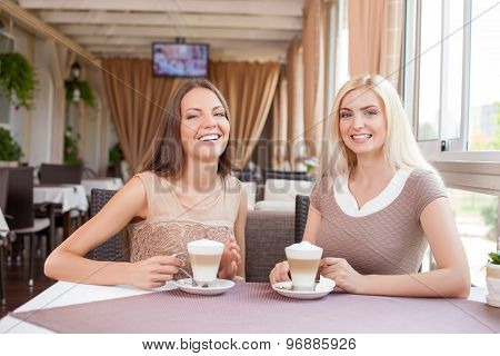 Cheerful young female friends are resting together