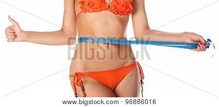 Girl Measuring Waistline And Shows Thumb Up.