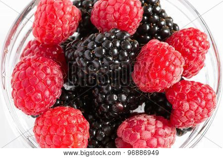 Blackberries with raspberries mixed in the glass bowl