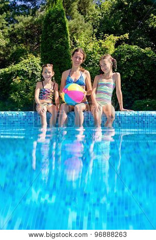 Happy family with kids having fun in swimming pool on vacation, underwater and above view
