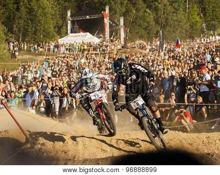 Fourcross Biker Race, Fight On The Race With People On Background - Editorial