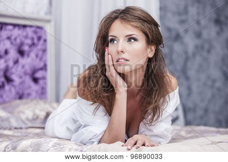 Female Model Beautiful Sexy In White Shirt On White Bed In The Morning