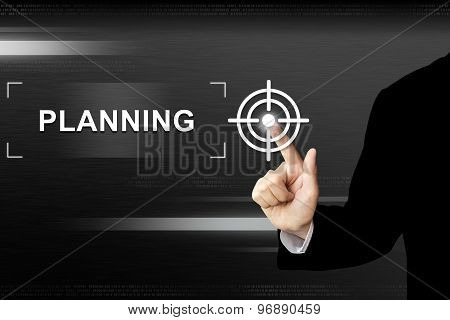 Business Hand Pushing Planning Button On Touch Screen