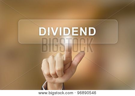 Business Hand Clicking Dividend Button On Blurred Background