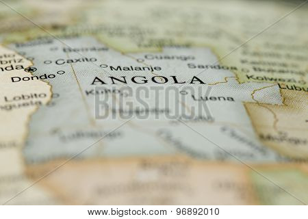 Macro of Angola on a globe, narrow depth of field