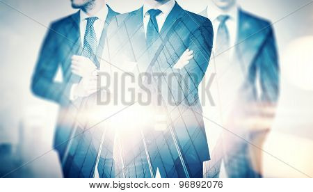Double exposure of businessmen and skyscraper on megalopolis back
