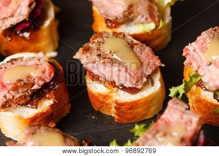 canape with beef meat
