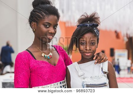 Two Beautiful Young African Girls Posing At Expo 2015 In Milan, Italy