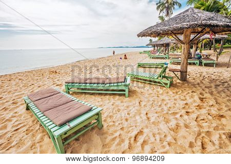 PHU QUOC, VIETNAM - APRIL 18, 2014: Tourists sunbathing on sand of Long beach near old hotel. Long Beach is the most popular beach on Phu Quoc island, about 5 km long, located south of Dong Dong town