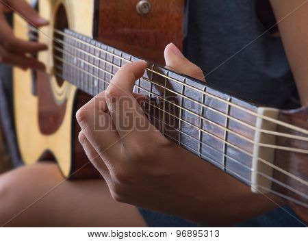 Playing On The Guitar, Closup.