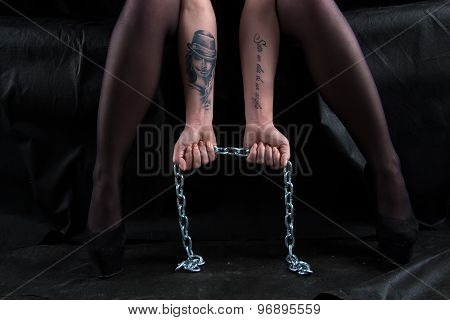 Photo of sitting woman holding chain