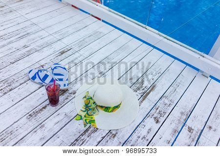Pair of colored sandals on a white summer wooden floor