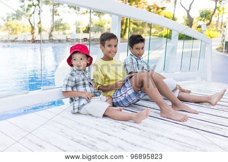 Kids in resort with tablet