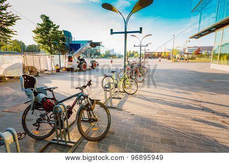 Parked Bicycles On Sidewalk Near Sanoma House in HELSINKI, FINLA