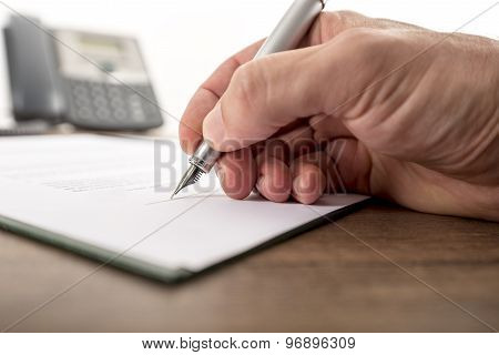 Businessman Or Lawyer Signing Important Document, Legal Papers, Contract Or Report