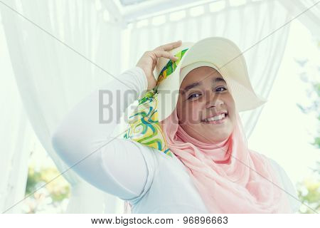 Happy Muslim family on summer vacation on bed