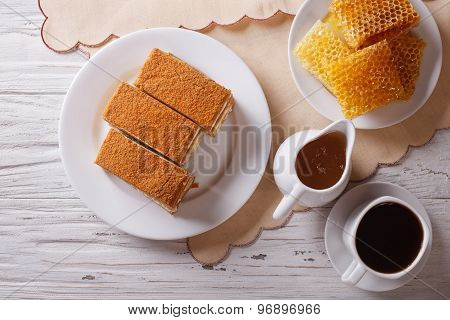 Honey Cake, Coffee, And A Honeycomb. Horizontal Top View