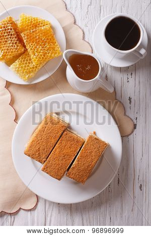 Honey Cake, Coffee, And Honeycomb. Vertical Top View