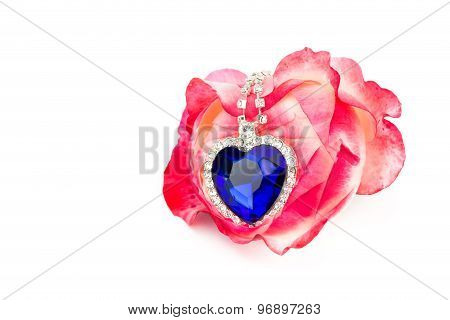 Blue Jewelry Heart Hanging In Red Rose