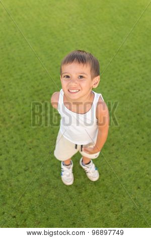 Kid on green grass