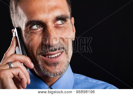 Portrait of a smiling businessman talking on the phone