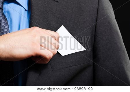 Unrecognizable businessman taking a greeting card from his pocket
