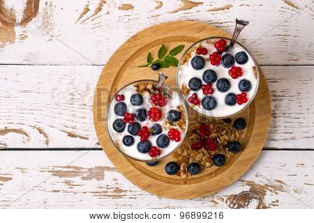 Yogurt, Muesli And Berries Of Blueberry And Stone Bramble
