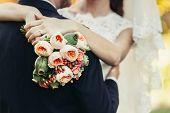 Постер, плакат: Bride Hug Groom With Wedding Bouquet