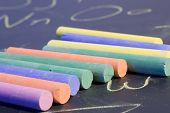 foto of midterm  - pieces of chalk placed on a chalkboard that has the alphabet written on it - JPG