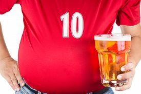 pic of big belly  - Obese man with big belly holding a glass of refreshing cold beer - JPG