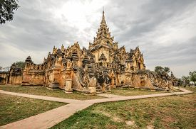 pic of nu  - Maha Aung Mye Bon Zan Monastery well known as Me Nu Oak Kyaung or the Brick Monastery was built by Nanmadaw Me Nu Chief Queen of King Bagyidaw in 1818 in Inwa ancient cityMandalay StateMyanmar - JPG