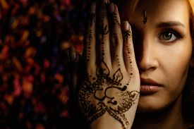 stock photo of vedic  - Woman with traditional mehndi henna ornament  - JPG