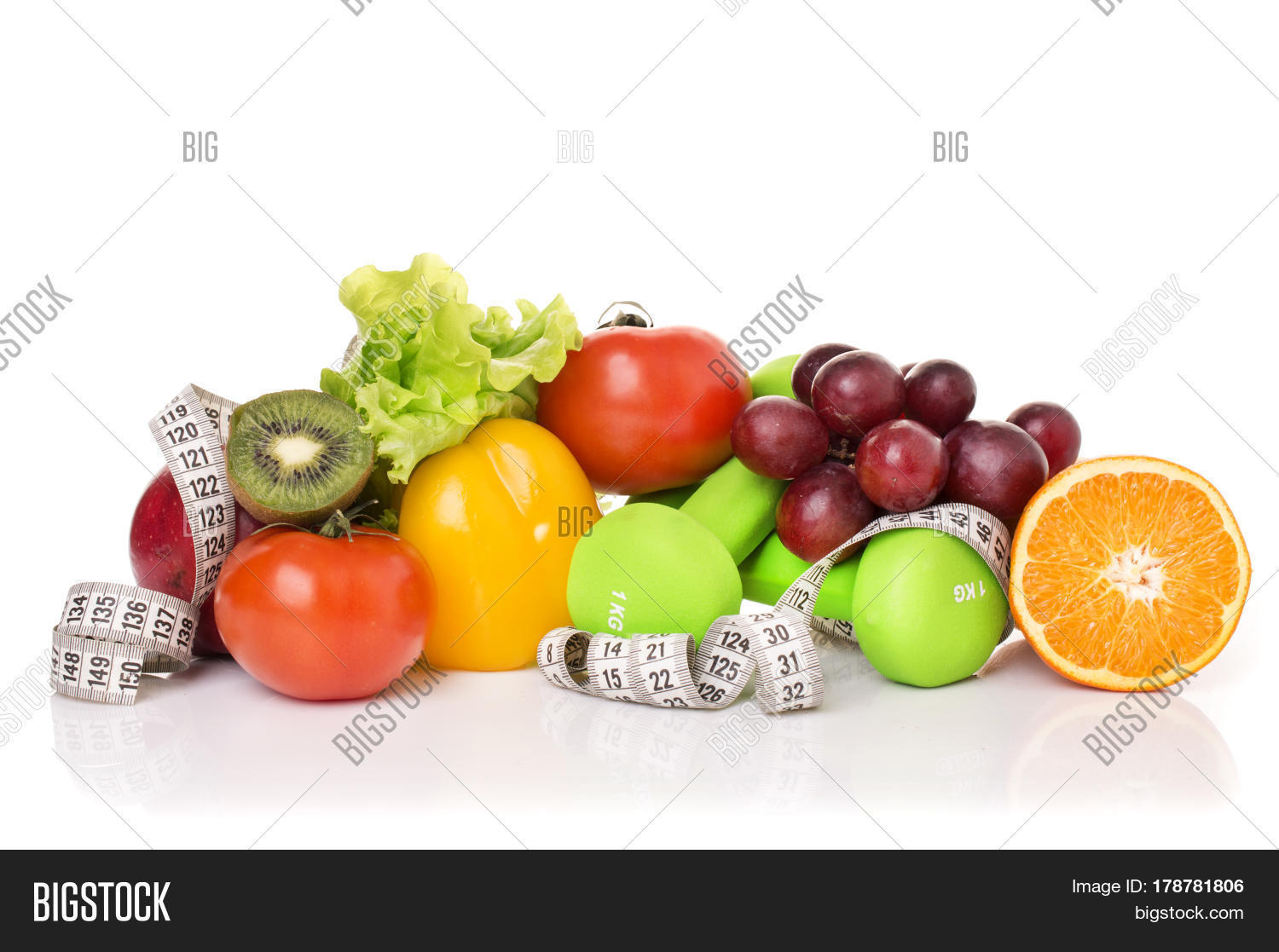 Fitness equipment and healthy food isolated on white