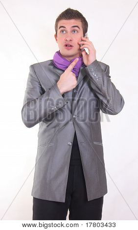 Young Man, Talking To A Mobile Phone, On White Background