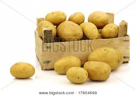 Bunch of freshly harvested potatoes in a wooden box