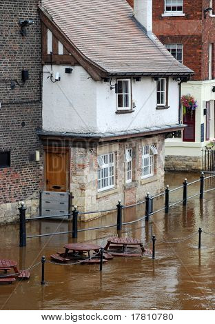 Rising flood waters on bank of York's River Ouse.