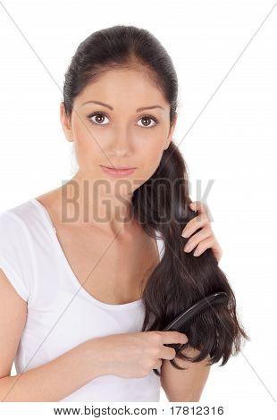 Young Brunette Beautiful Woman Combing Long Hairs
