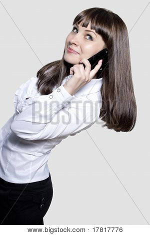 Young business lady with phone
