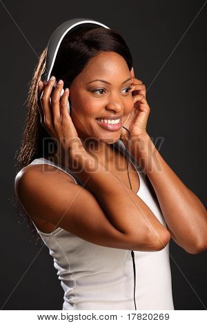 Girl smiling listening to music
