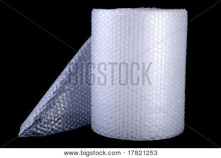 Bubble wrap used for packaging fragile items on black background