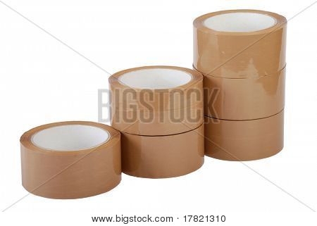 Ascending towers of brown packaging tape on white background