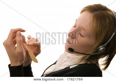 Distracted call centre operative filing her nails