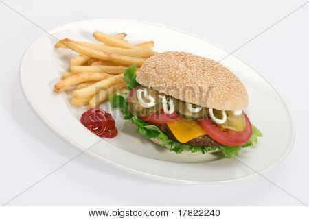A loaded cheeseburger with french fries and tomato sauce