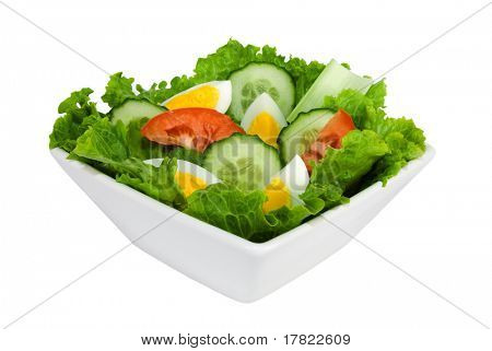 A healthy bowl of green leaf salad isolated on a white background
