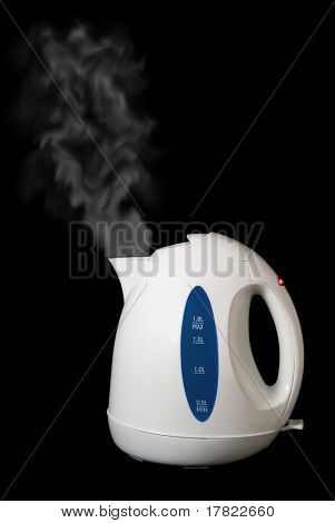 Kettle on a black background emitting steam