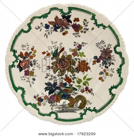 An early 19th century Staffordshire plate hand painted over a transfer outline with moulded border - genuine antiques series