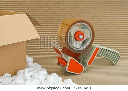Tape gun and packaging materials