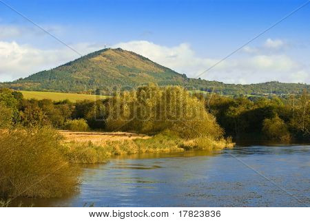 The Wrekin with river Severn in foreground, Shropshire, UK