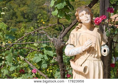 Lost and forgotten overgrown garden with broken statue